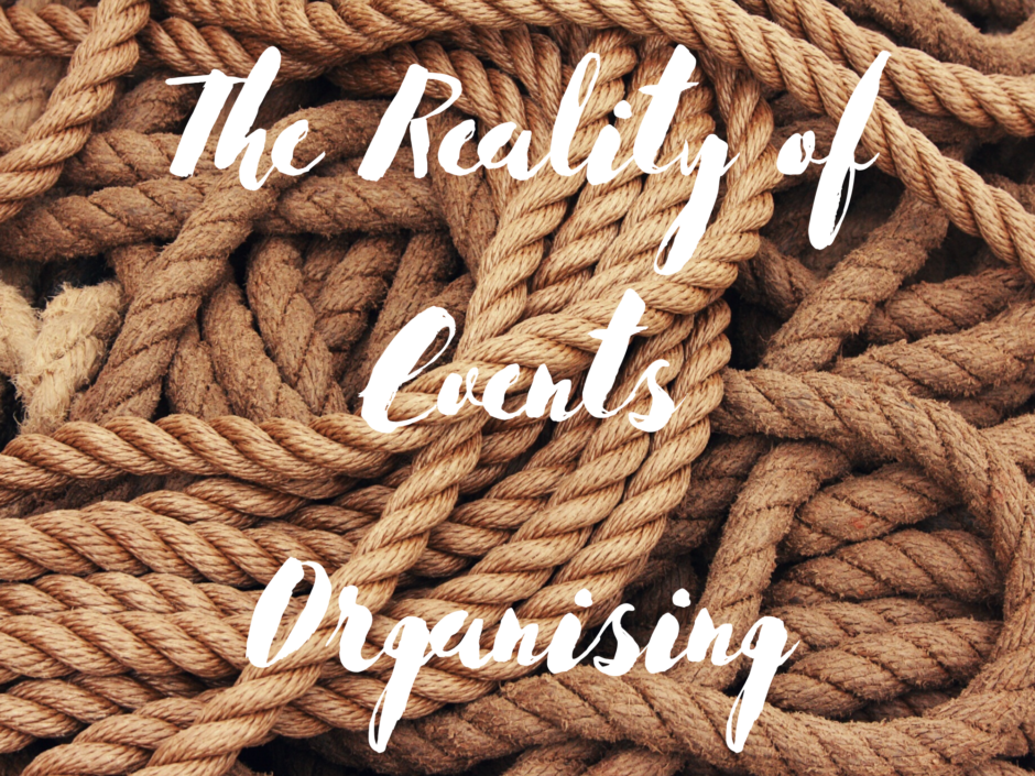 "The words ""the reality of events organising "" on a background of coiled natural fibre rope"