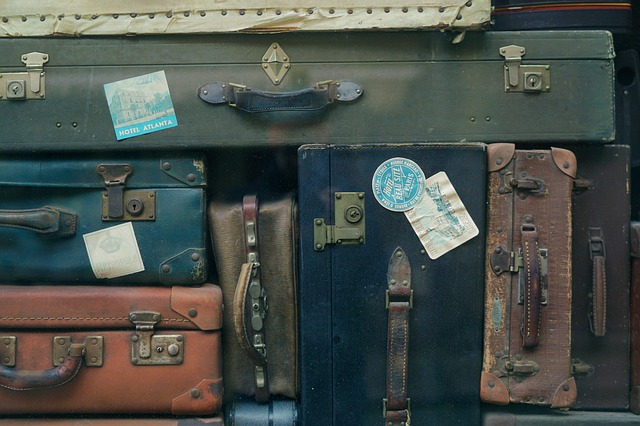Close-up image of a pile of old fashioned suitcases. For post about baggage.