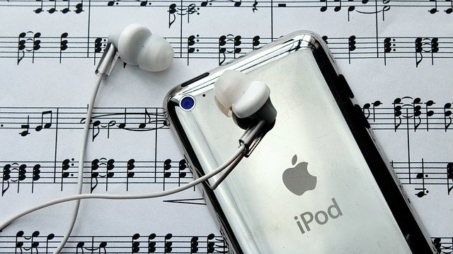 An iPod resting on some sheet music. For a post about love songs