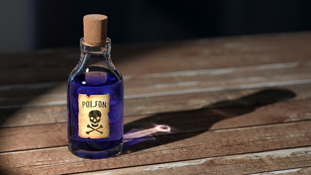 "An old fashioned corked bottle filled with blue liquid and labelled with a skull and crossbones and the word ""poison."" For a post on toxic ingredients in lube"