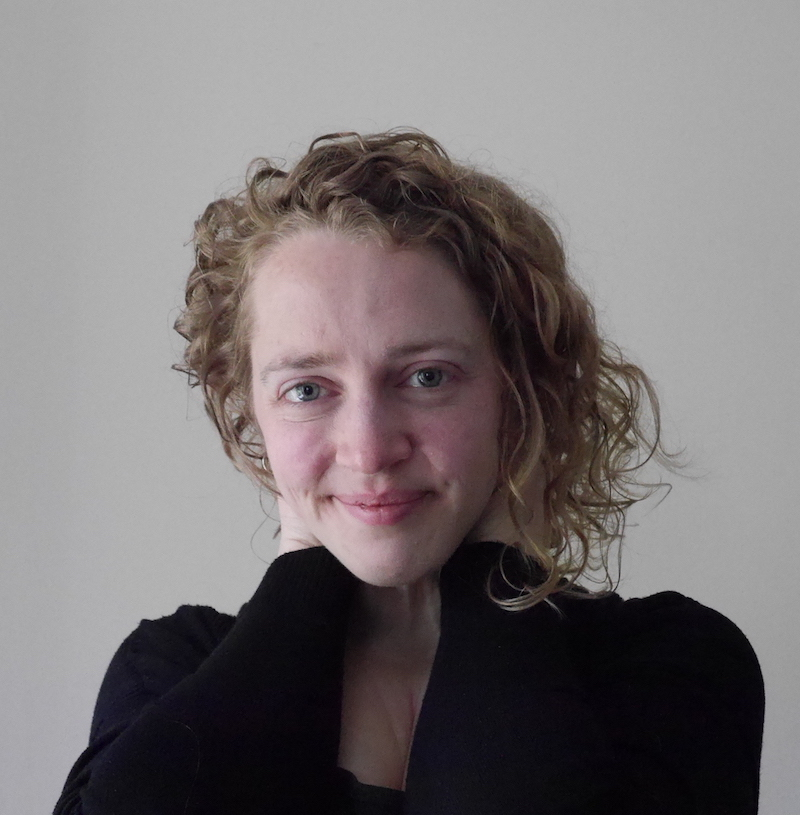 Headshot of Christine Woolgar, a while woman with blonde curly hair, smiling and facing the camera. For a post about sex therapy