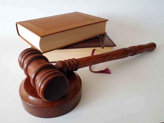 A judge's gavel and 2 books for a post on historical sexual laws