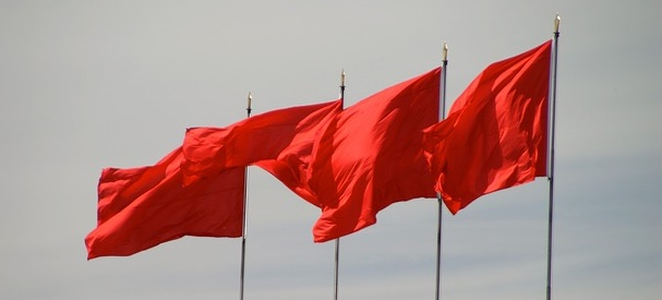 Four red flags blowing in the wind