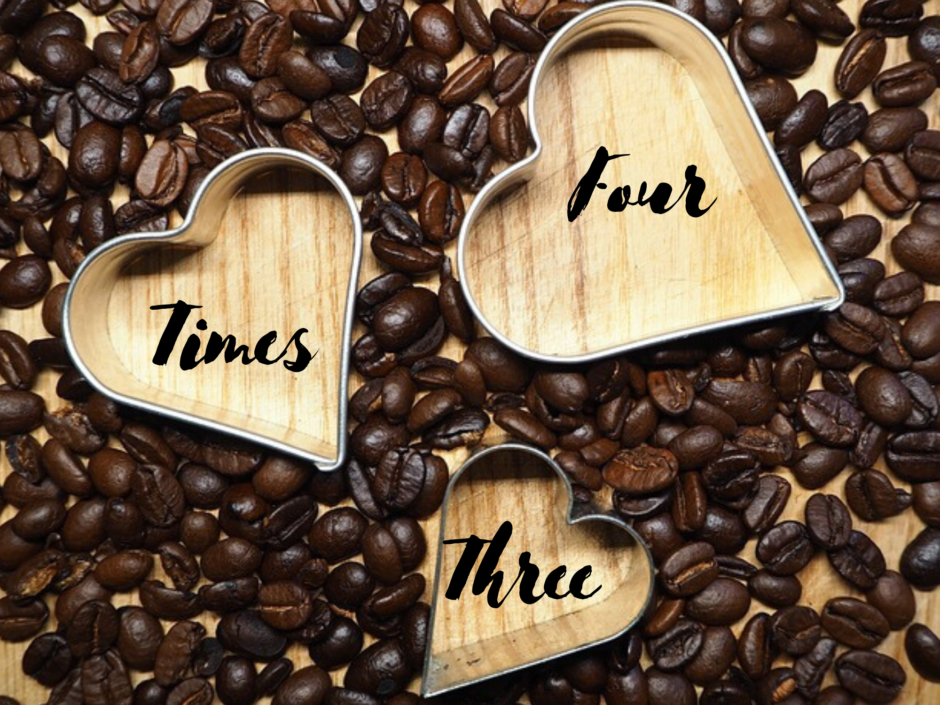 Three heart shaped cookie cutters among a bed of coffee beans. For a post about threesomes