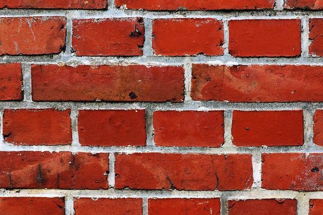 A close up of a section of red brick wall, for a post about rules