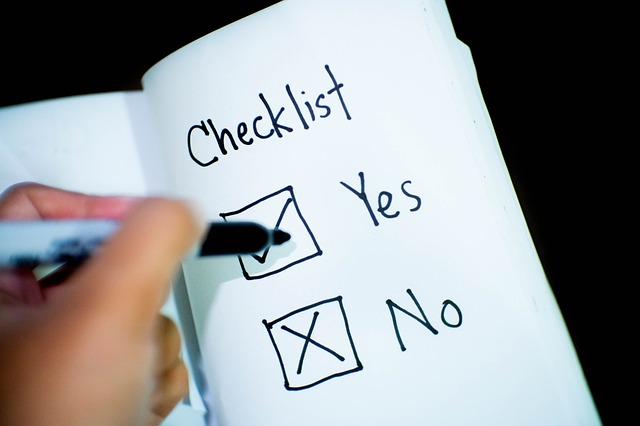 "A yes/no checklist with a person's hand ticking the ""yes"" box. For a post on negotiation tools."