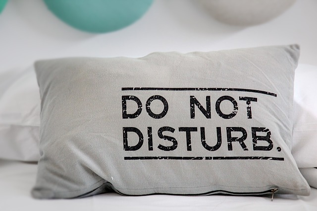 "A white pillow with the words ""do not disturb"" in black. For a post on sleep sex and pre consent"