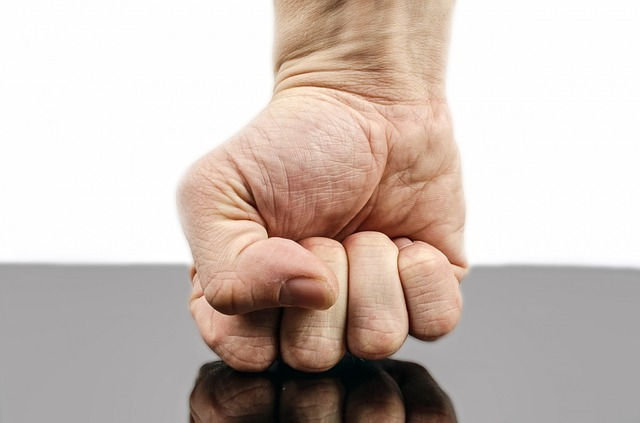 A white male fist punching downwards onto a hard surface. For a post on how not to punish your submissive.