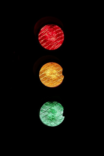 A set of traffic lights on s dark background, red, amber and green, for a post about safewords