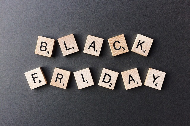 "Scrabble letters spelling out ""Black Friday."" For the discounts, deals and offers page."