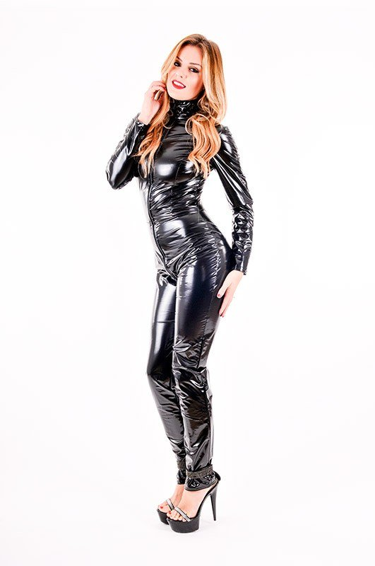 A black PVC full body catsuit, modelled by a pretty white woman with blonde hair.
