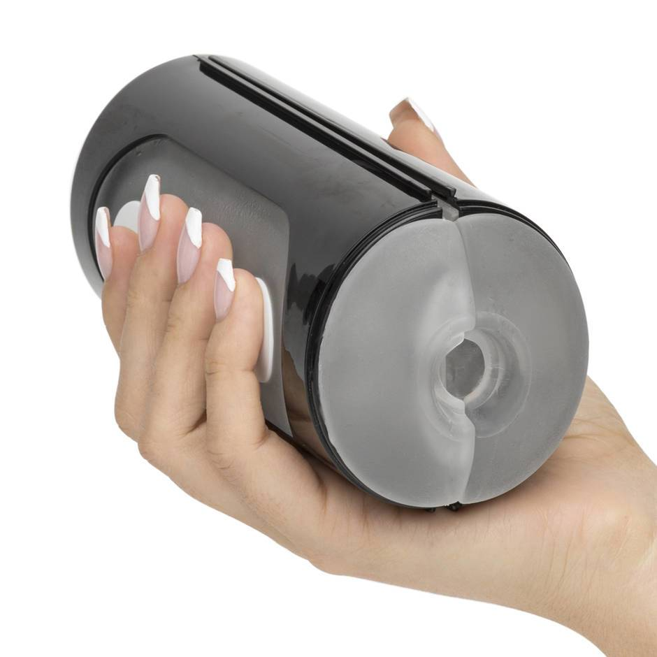 The Tenga Black Flip Hole, a black male masturbation sleeve with buttons on the side, held in a female hand.