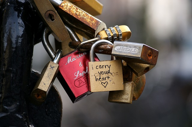 "A fence with padlocks with love messages fastened to it. For a post called ""I'm Not Going to Steal Your Boyfriend"""