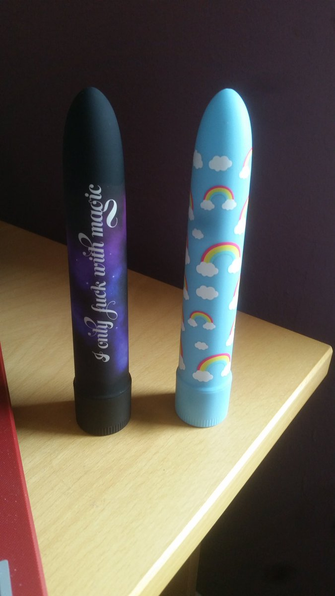 Two Positive Vibes vibrators standing side by side on my desk.