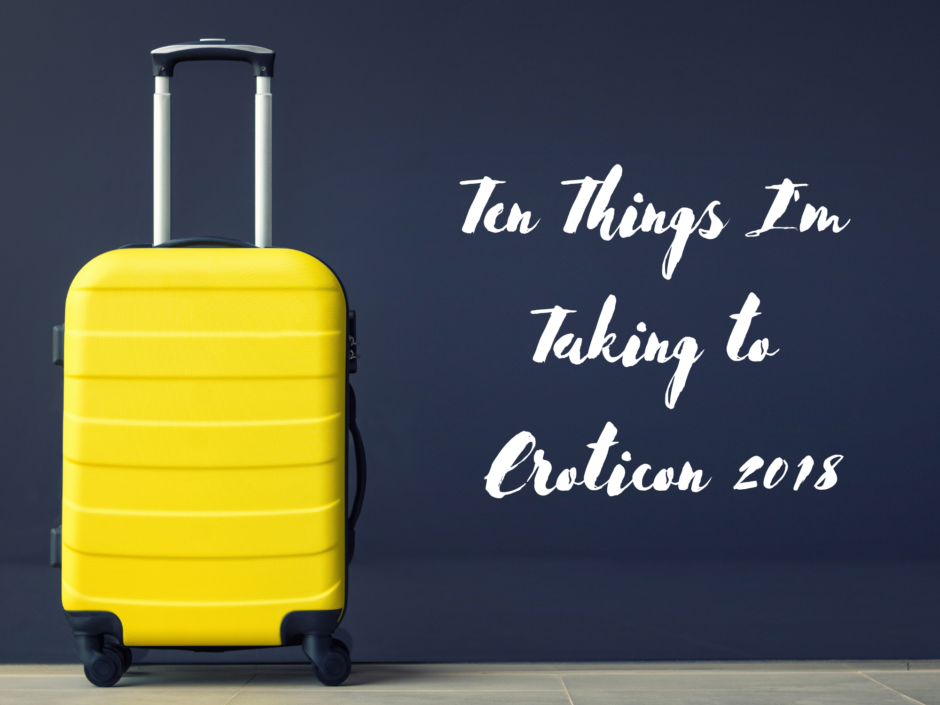 A yellow suitcase on a dark background, for a post about things I'm taking to Eroticon 2018