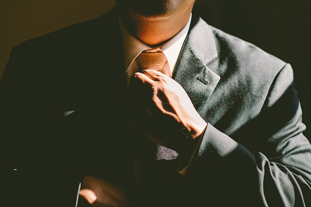 A man's body in a suit and tie. For a masturbation monday post about a charity dinner