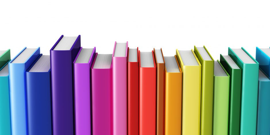 Rainbow books on a shelf