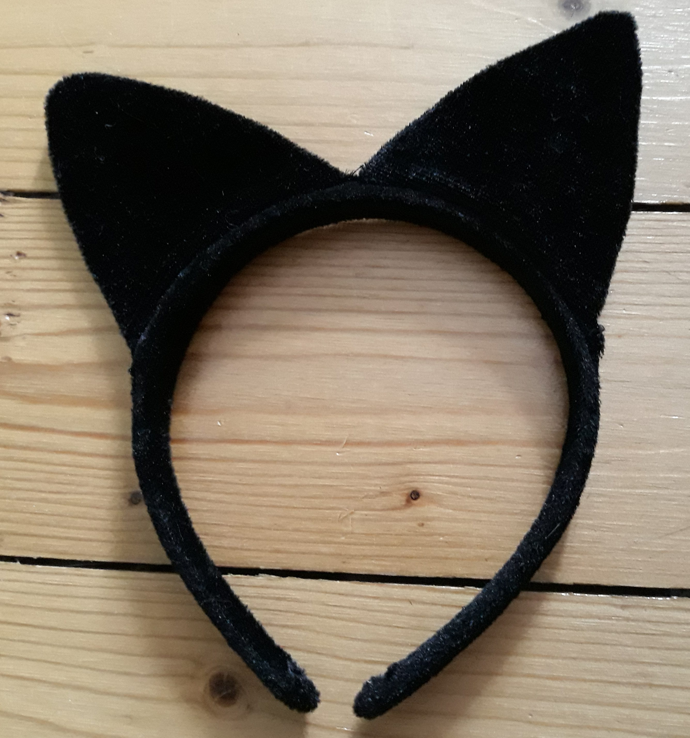 A pair of black cat ears on a headband. For a Masturbation Monday post called On The Prowl