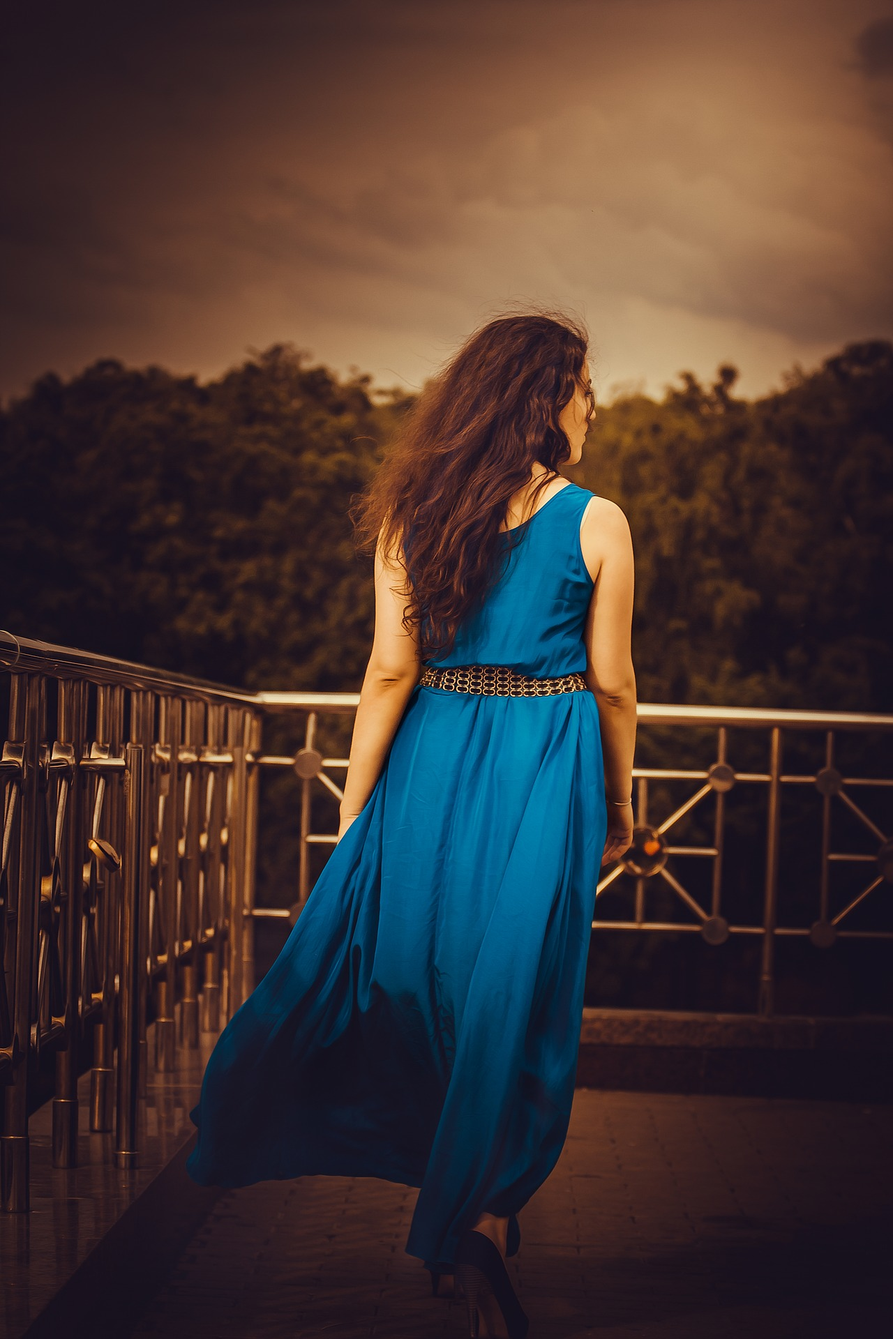 A girl in a blue dress from the back, for a Masturbation Monday post about fucking after a wedding