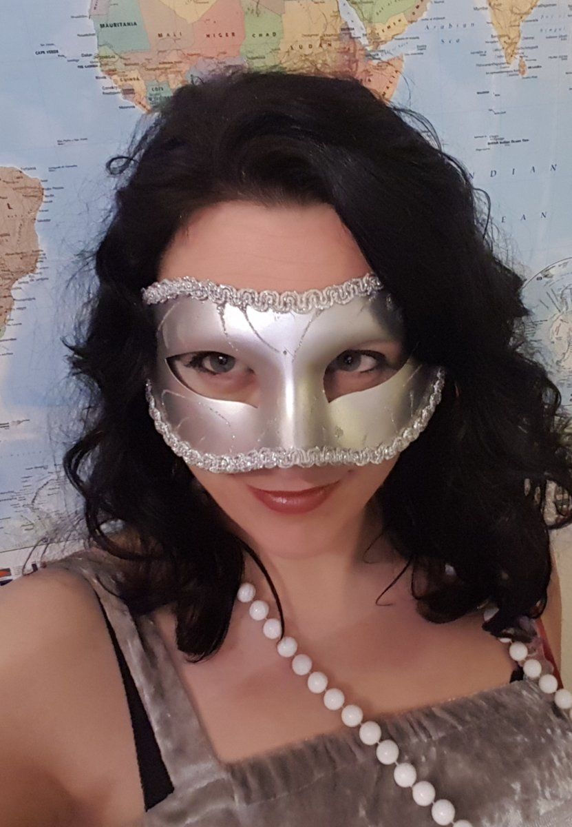 Little Welsh Minx in a masquerade mask.