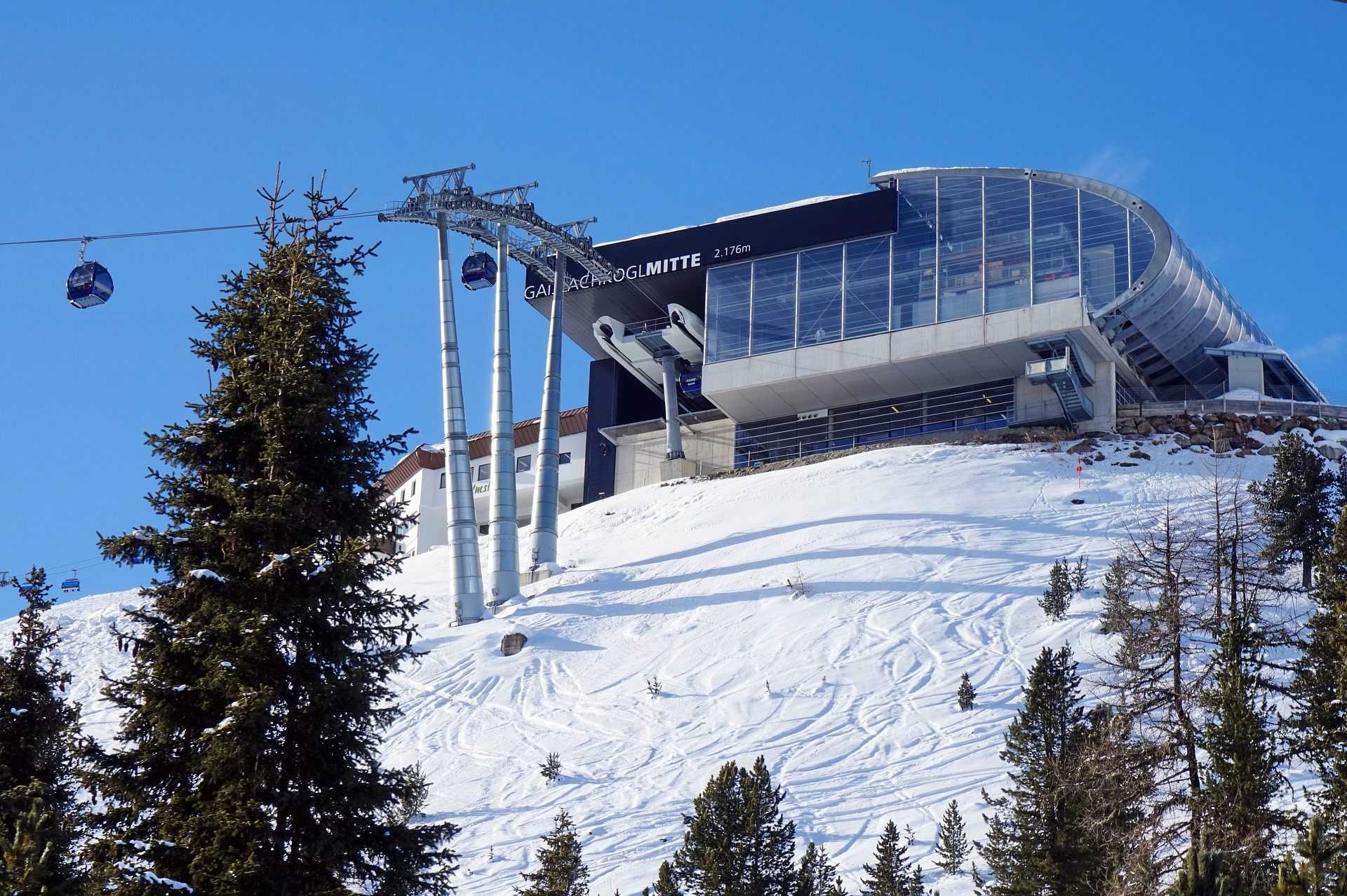 A snowy slope with a ski lift. For a post about group sex and the slippery slope fallacy.