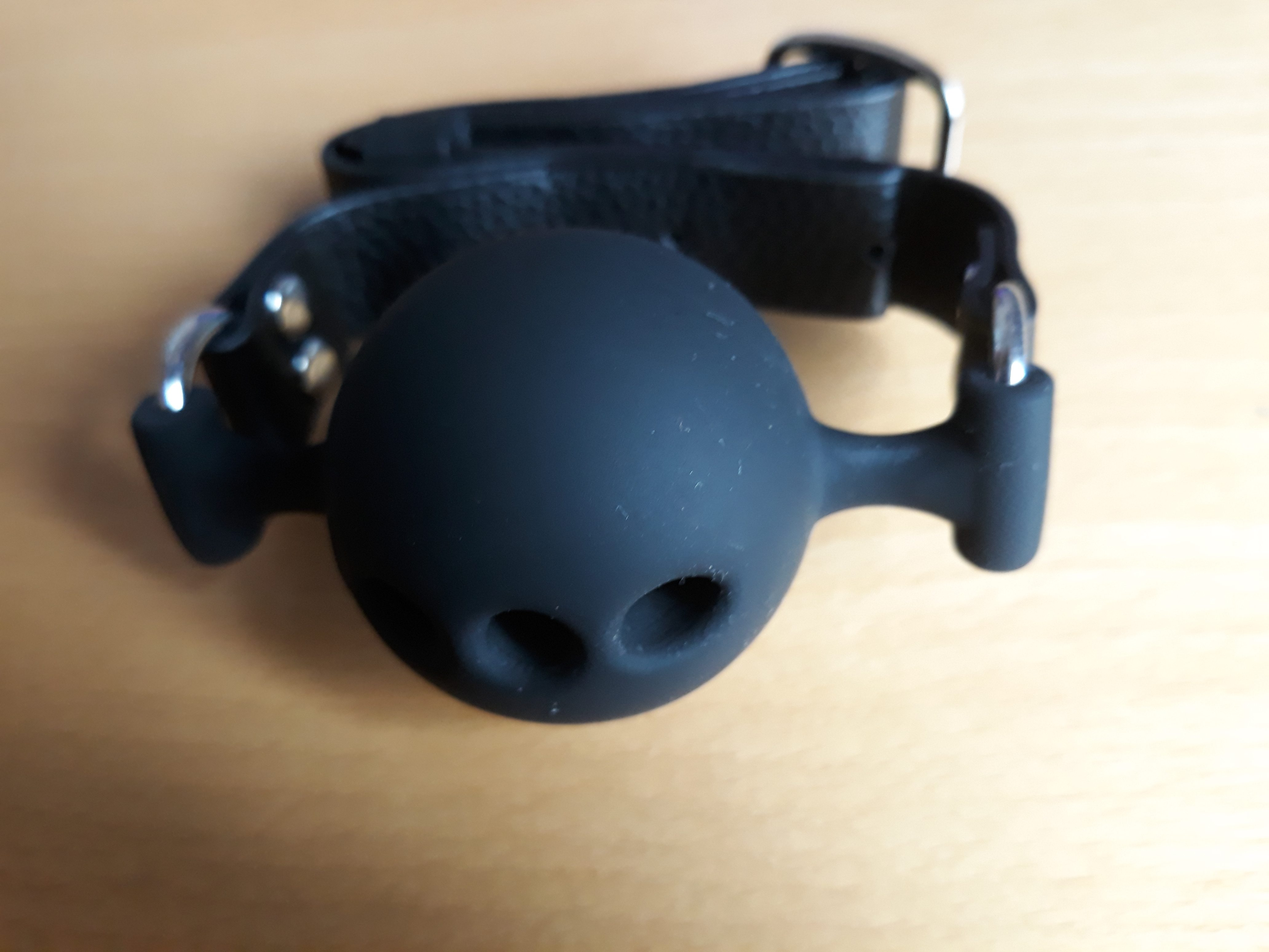 A black ball gag. For a post about the Take Control bondage kit.