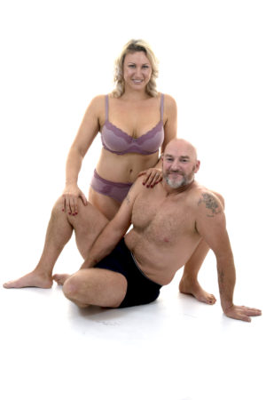 Charlotte and Colin from Sexercise Fitness smilng at the camera in their underwear
