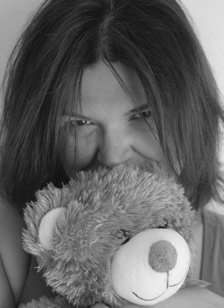 A picture of Kayla Lords cuddling a big teddy bear