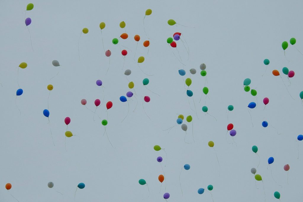 A sky full of balloons in different colours. For a post about forgiveness and letting go.