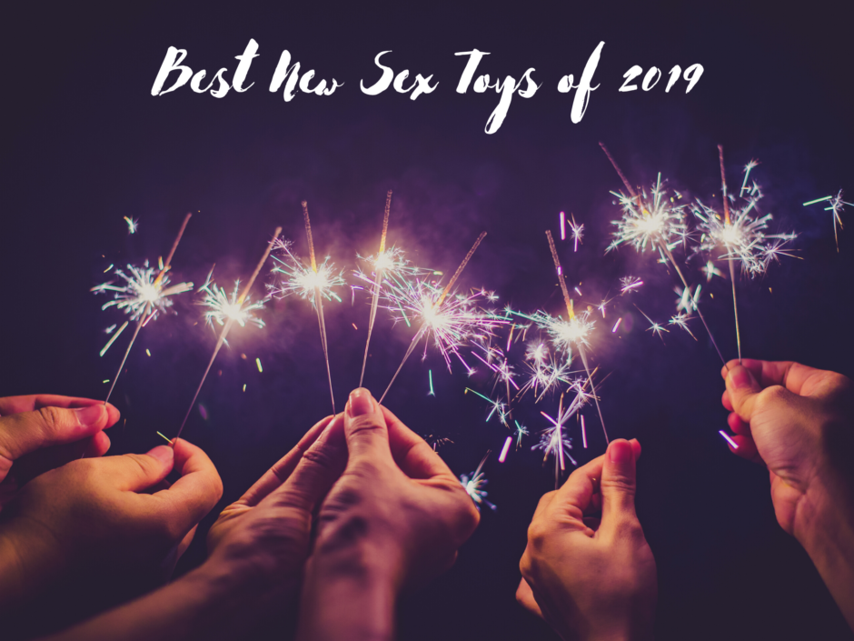 A group of hands holding sparklers. Header image for the Best Sex Toys of 2019 round up