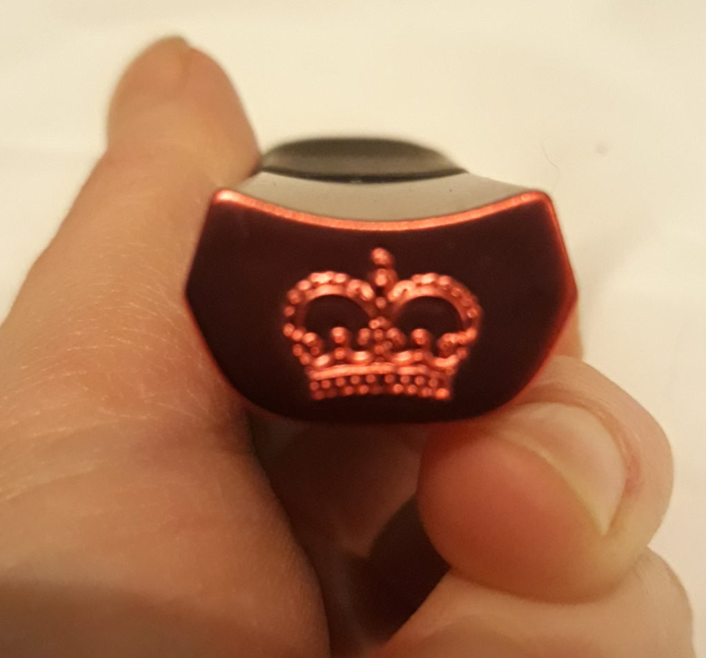 The base of the Hot Octopuss AMO vibrator with the company's crown logo stamped into it.