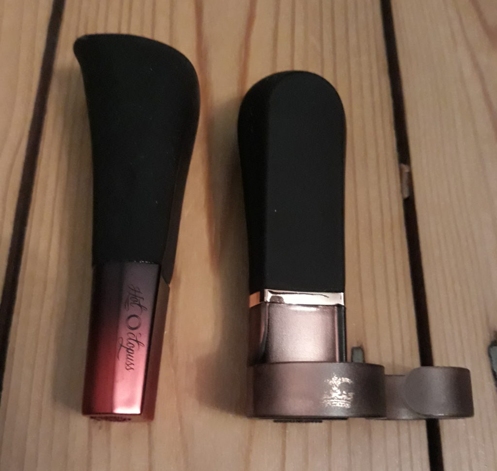 The Hot Octopuss DiGiT and AMO vibrators lying side by side on  wooden floor.