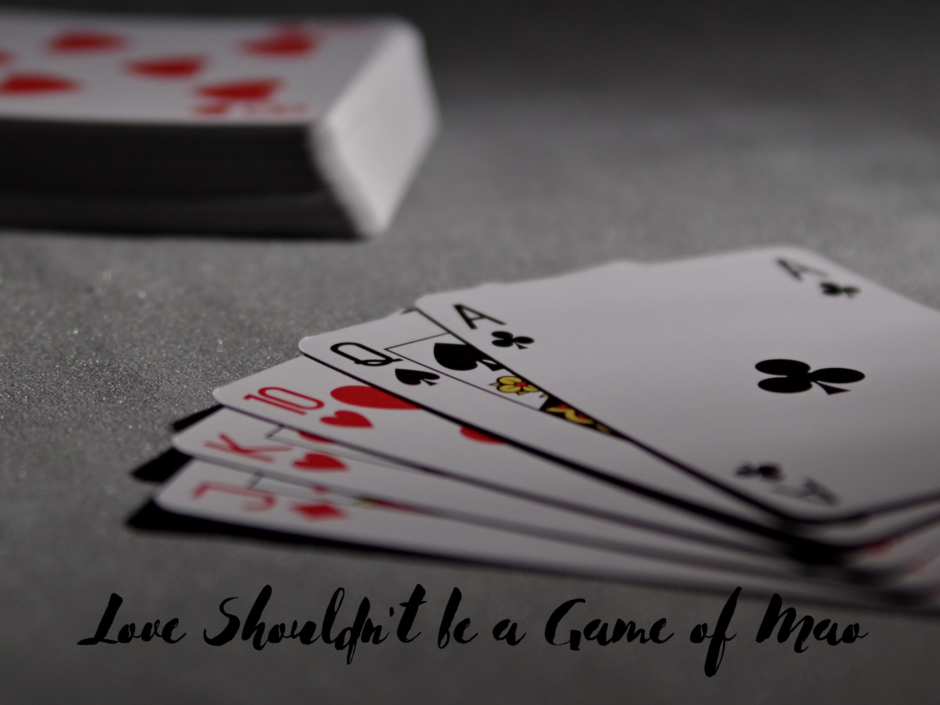 A hand of cards. For a post about the game Mao and abusive relationships
