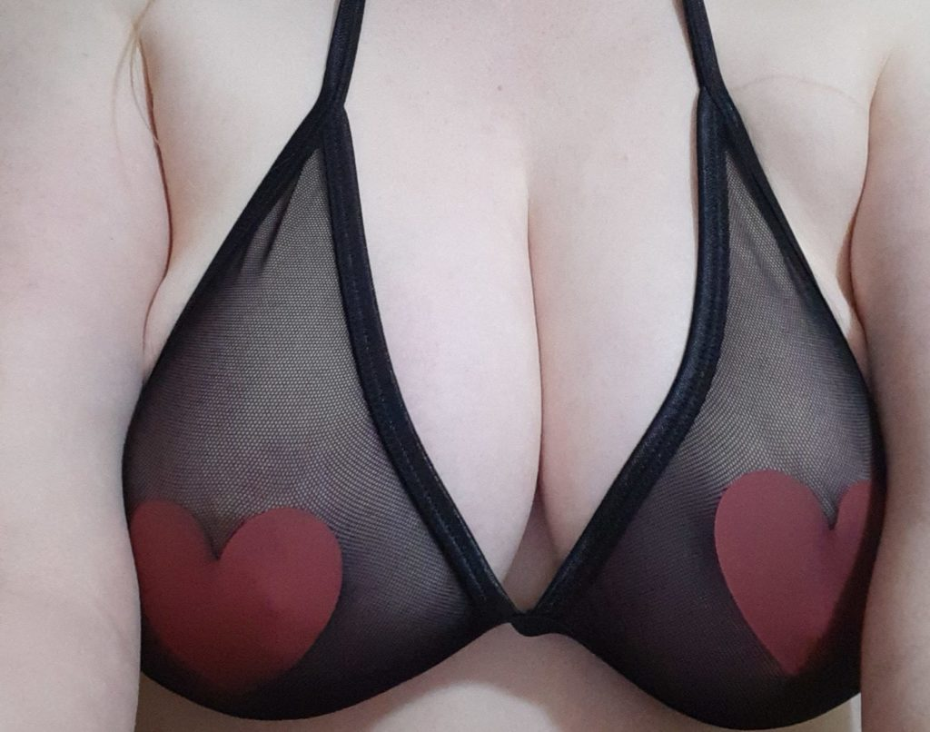 A close up of a person with large breasts wearing the Hot For You bra