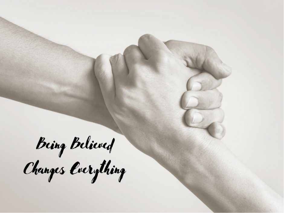 Clasped hands, for a post about being believed as a survivor of abuse