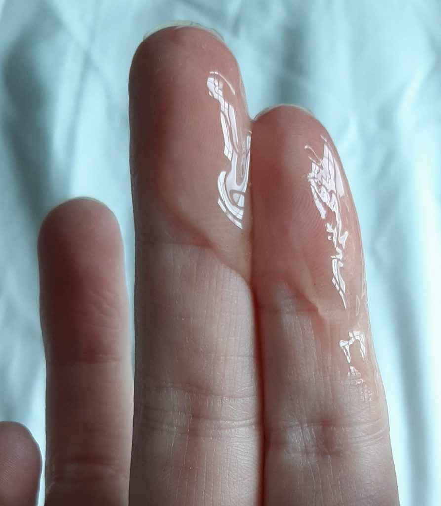 Fingers coated in water-based lube