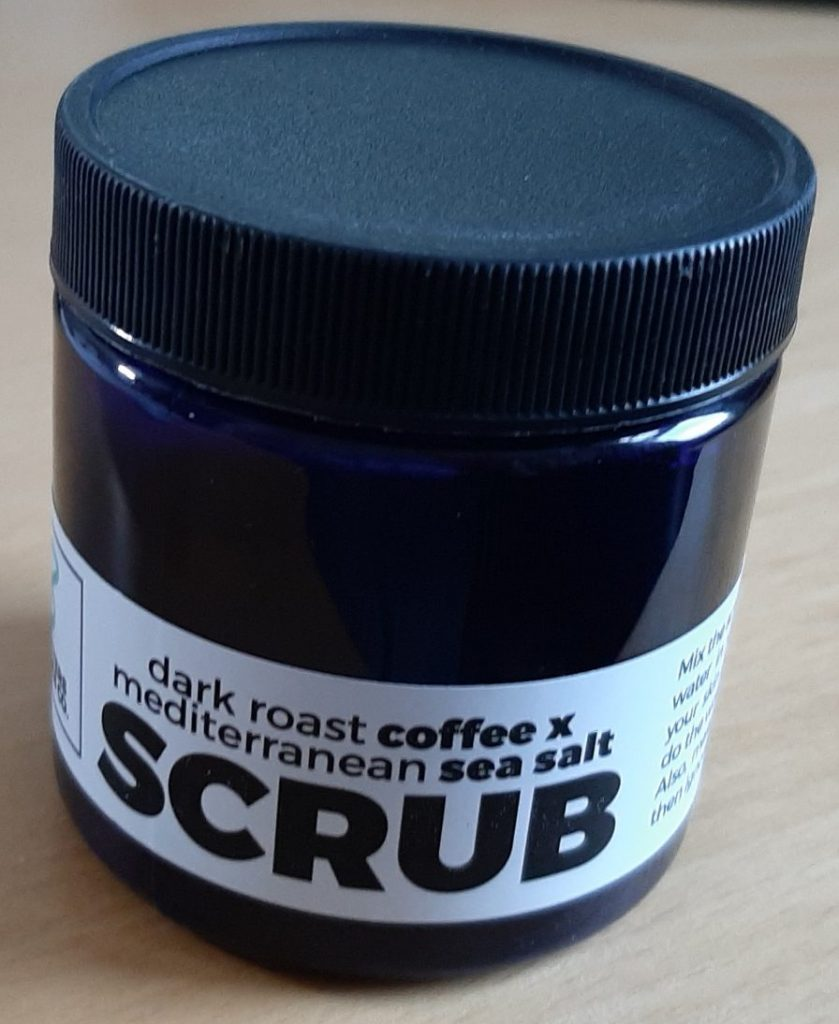Jar of coffee body scrub with sea salt