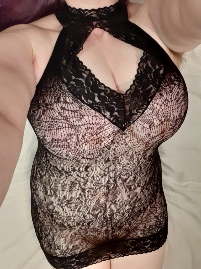 Woman in Fifty Shades of Grey lingerie black lace spanking dress