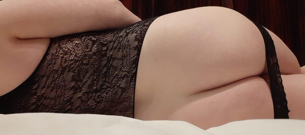 Womans butt in black lace lingerie spanking dress