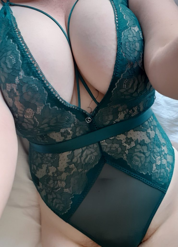 Curvy woman with big natural boobs wearing lace bodysuit plus-size lingerie