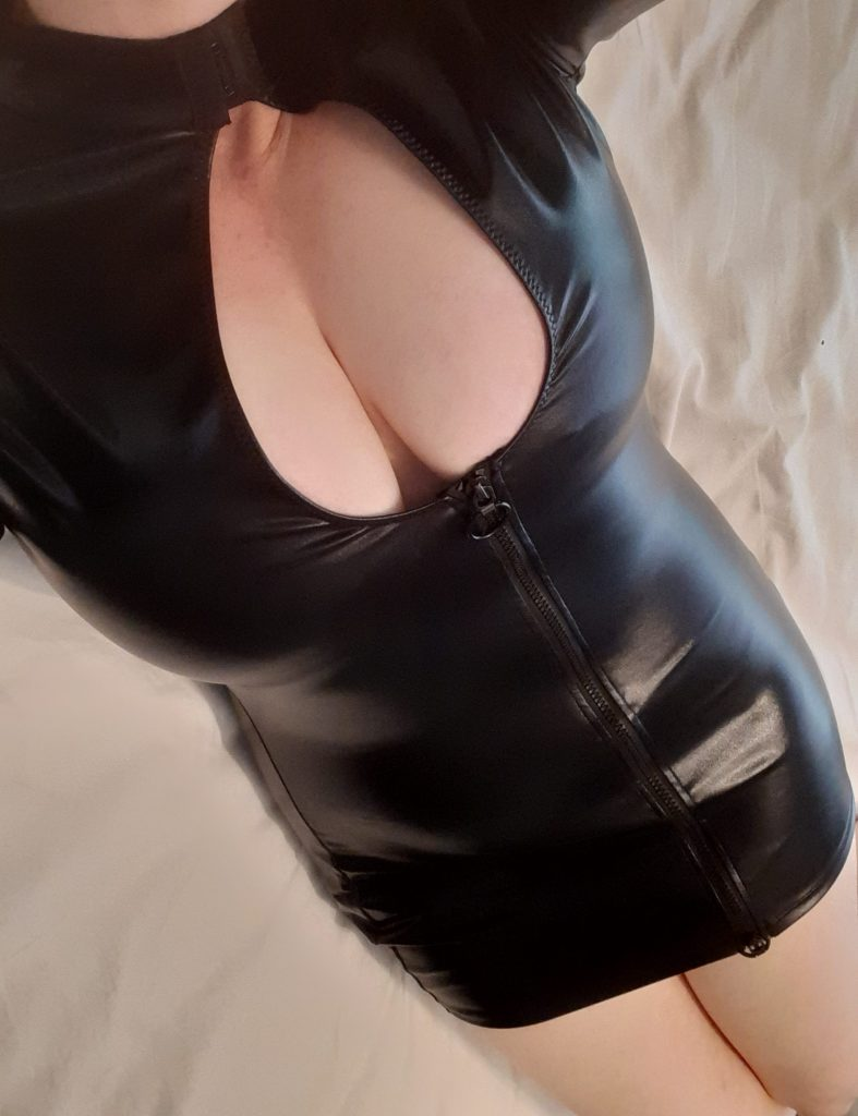 Woman with big boobs wearing Lovehoney Fierce wet look cut out mini dress